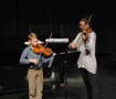 Strings Adjudicator. Maria Medlow, works with Festival participant, Melvin Jarnagin.